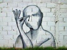 Art urbain ouvrez vos yeux blessés photo libre de droits