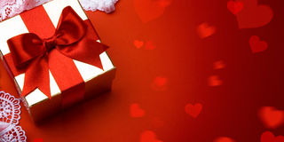 Art valentine day; golden gift box on red background stock images