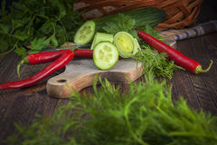 Art vegetable early board table wooden parsley dill pepper cucumber leek royalty free stock photography