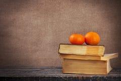 Art vintage background oranges board books wood wooden Royalty Free Stock Images
