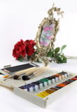 Art water color paints. Still life with water color paints, brushes, pencils and a mirror Royalty Free Stock Photography