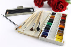 Art water color paints. Still life with water color paints, brushes, pencils and a mirror Royalty Free Stock Images