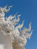 Art of white Naga on temple roof Stock Image