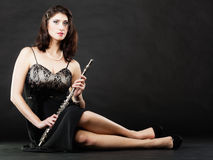 Art. Woman flutist flaustist musician with flute. Art and artist. Full length of young woman elegant girl flutist flautist musician perfomer with flute musical Stock Images