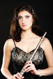 Art. Woman flutist flaustist musician with flute Stock Photo