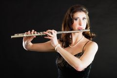 Art. Woman flutist flaustist musician playing flute Stock Image