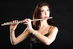 Art. Woman flutist flaustist musician playing flute. Art and artist. Young woman elegant girl flutist flautist musician perfomer playing flute musical instrument stock photo