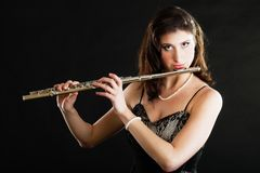 Art. Woman flutist flaustist musician playing flute. Art and artist. Young woman elegant girl flutist flautist musician perfomer playing flute musical instrument stock photos