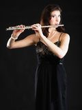 Art. Woman flutist flaustist musician playing flute Royalty Free Stock Images