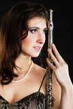 Art. Woman flutist flautist with flute. Music. Stock Photo