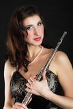 Art. Woman flutist flautist with flute. Music. Stock Images