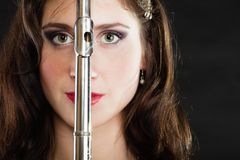 Art. Woman flutist flautist with flute. Music. Stock Photos