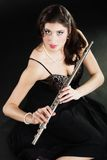 Art. Woman flutist flautist with flute. Music. Stock Image