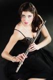 Art. Woman flutist flautist with flute. Music. Stock Image