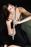 Art. Woman flutist flautist playing flute. Music. Stock Photos