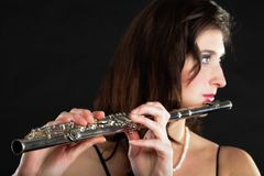 Art. Woman flutist flautist playing flute. Music. Royalty Free Stock Photo