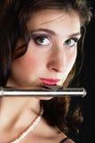 Art. Woman flutist flautist playing flute. Music. Stock Image