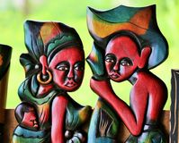 A couple with a baby sculpted and painted as handicraft from sao tome and principe. Art wooden sculpture from sao tome and principe. A man and a woman with is Stock Image