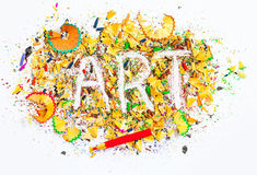 Art word on the background of bright colored pencil shavings Royalty Free Stock Photos