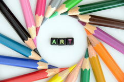 ART word. Surrounded with color pencils Stock Photo