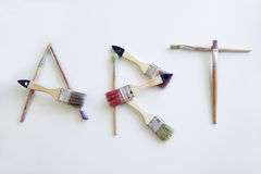 'art' writting by brushes. The word 'art' written by brushes. Isolated on the white background Stock Image