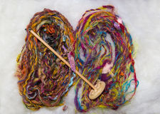 Art yarn and handspindle Stock Images