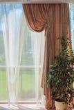 Art yellow curtain room comfort.  Stock Photos