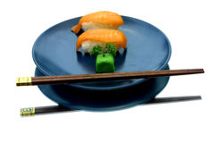 Art of Zen 2. Sushi on a blue plate, white background royalty free stock image
