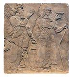 Arte asirio en la pared, el rey Ashurnasirpal II y el genio Fotos de archivo libres de regalías