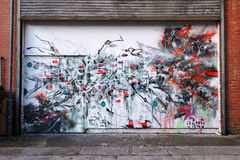 Arte astratta dei graffiti su un'entrata della costruzione Fotografie Stock Libere da Diritti