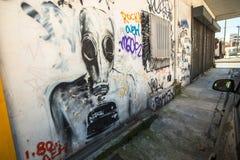 Arte contemporanea dei graffiti sui mura di cinta La Grecia Immagine Stock