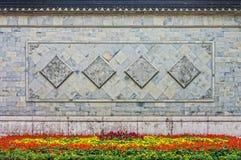 A arte da cerca de pedra chinesa oriental em um jardim Imagens de Stock Royalty Free
