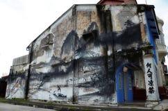Arte da parede da evolução pintada pelo artista famoso, Ernest Zacharevic em Ipoh Imagens de Stock Royalty Free