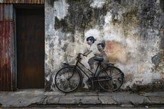 Arte de la calle del ciclista del hermano en George Town Fotografía de archivo libre de regalías