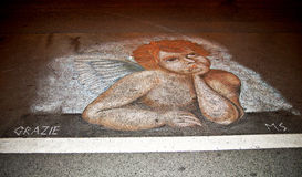 Arte de la calle en el asfalto Foto de archivo libre de regalías