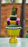 Arte de la hoja y de la flor, arroz que ofrece, tradición del plátano de tailandés Imagen de archivo