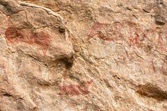 Arte de la roca en la cueva de Liphofung Foto de archivo libre de regalías