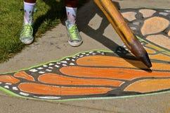 Arte de la tiza de un ala de la mariposa Fotografía de archivo