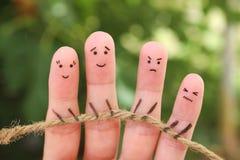 Arte de los fingeres de la gente que juega esfuerzo supremo con la cuerda imagenes de archivo