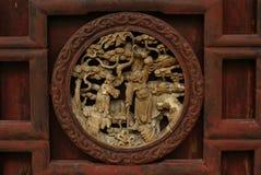 Arte de madera de una historia china Foto de archivo