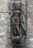 Arte de pedra histórica do vintage de deuses indianos em um templo indiano hindu antigo Imagens de Stock Royalty Free