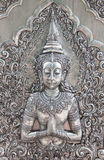 Arte de talla de plata del estilo tailandés en la pared del templo Fotografía de archivo libre de regalías