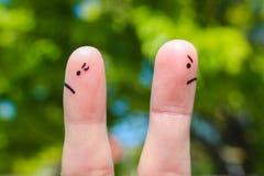 Arte del finger de pares después de la discusión que mira en diversas direcciones Foto de archivo