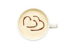 Arte del Latte - tazza di caffè isolata con i cuori fotografia stock libera da diritti