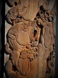 Arte dell'intaglio in legno all'installazione di arte di stile di fantasia della casa del nero di BAANDAMthe Fotografie Stock
