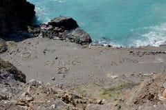 Arte della roccia della spiaggia Immagine Stock