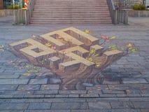 Arte della via che mostra illusione ottica Fotografie Stock Libere da Diritti