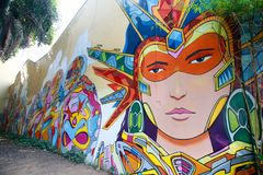 Arte della via di Singapore con la parete dei graffiti immagine stock