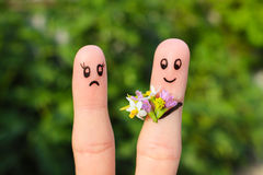 Arte do dedo dos pares o homem dá flores da mulher, ela não é satisfeito Foto de Stock