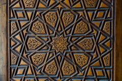 Arte do otomano com testes padrões geométricos na madeira Imagens de Stock